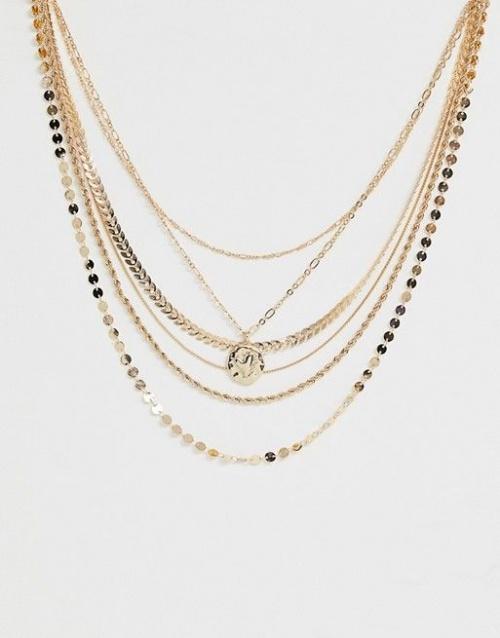 Collier multi-rangs varié avec chaînes et pendentif pièce effet fondu