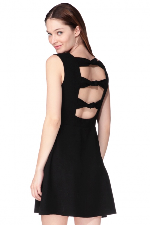 Kling robe patineuse noire noeuds dos