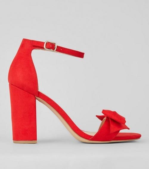 Sandales à talons en suédine rouge avec nœud sur le devant
