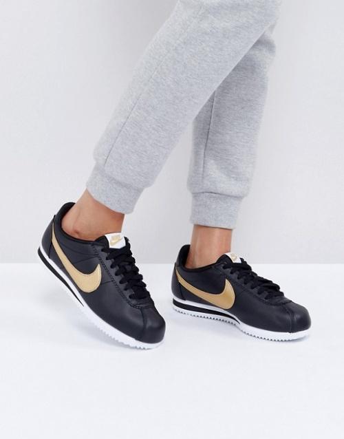 Nike - Baskets noires et doré