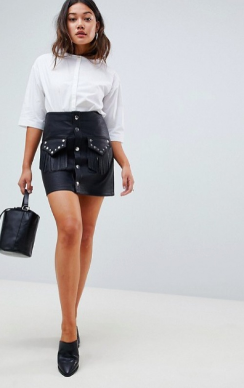 ASOS DESIGN - Mini-jupe en similicuir avec poche cloutée