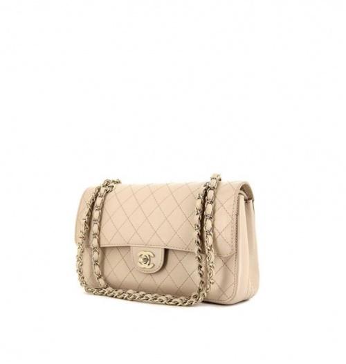 Chanel - Sac à main Timeless en cuir grainé matelassé beige