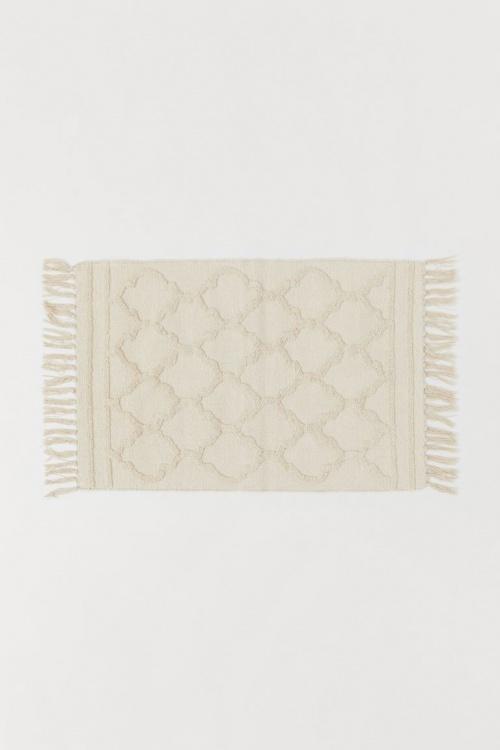 H&M Home - Petit tapis avec pompons