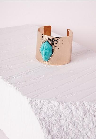 Bracelet Manchette dorée avec pierre