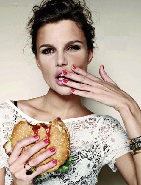 sexy girl eating a hamburger
